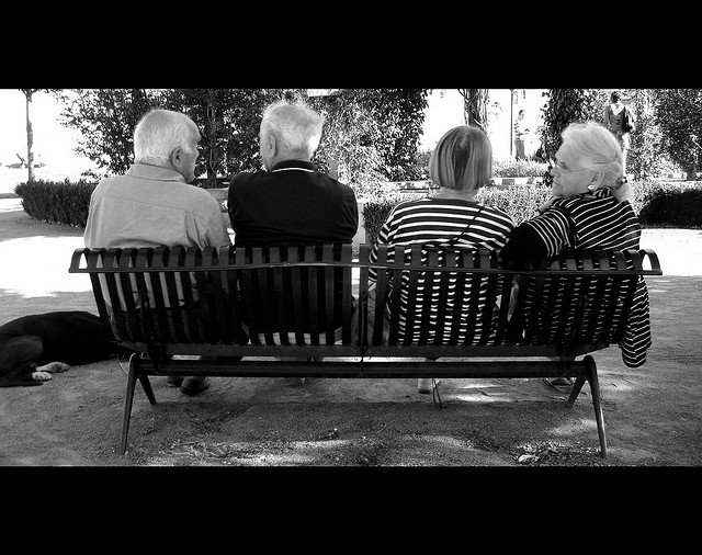 Senior Citizens Sitting on Bench