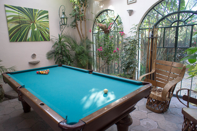 Pool table in outdoor sunroom