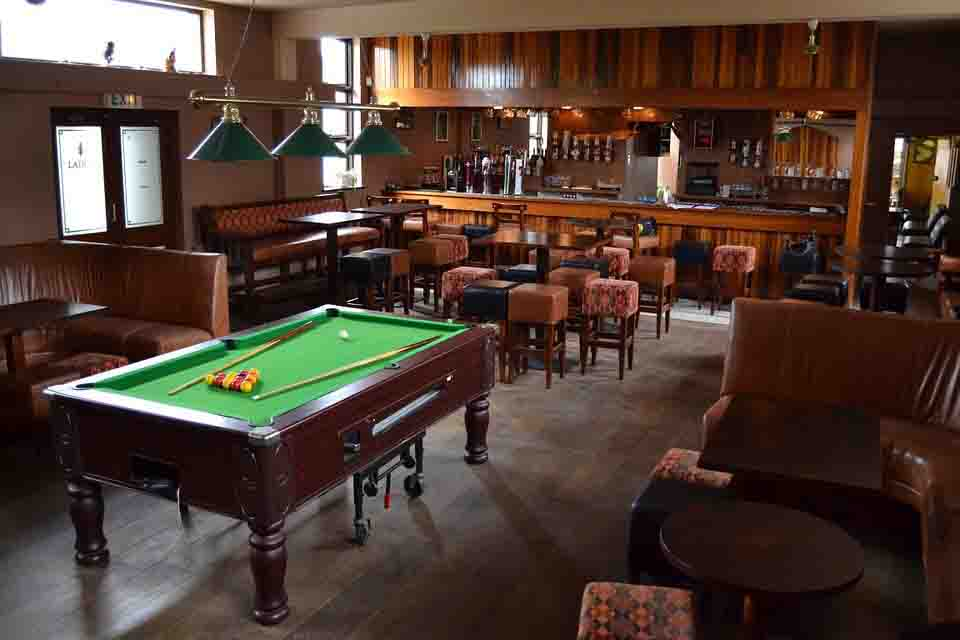 A Hotel Game Room and Pub with Billiards Table