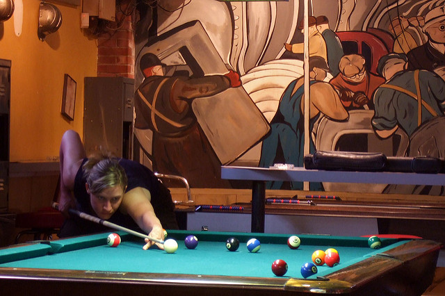 Woman shooting pool