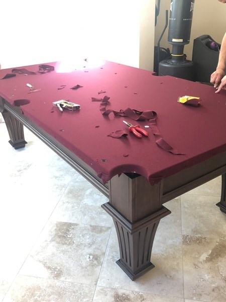 Trimming pool table felt