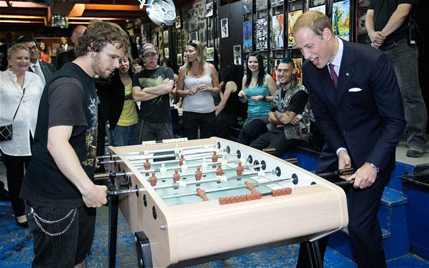 Prince William playing table football.